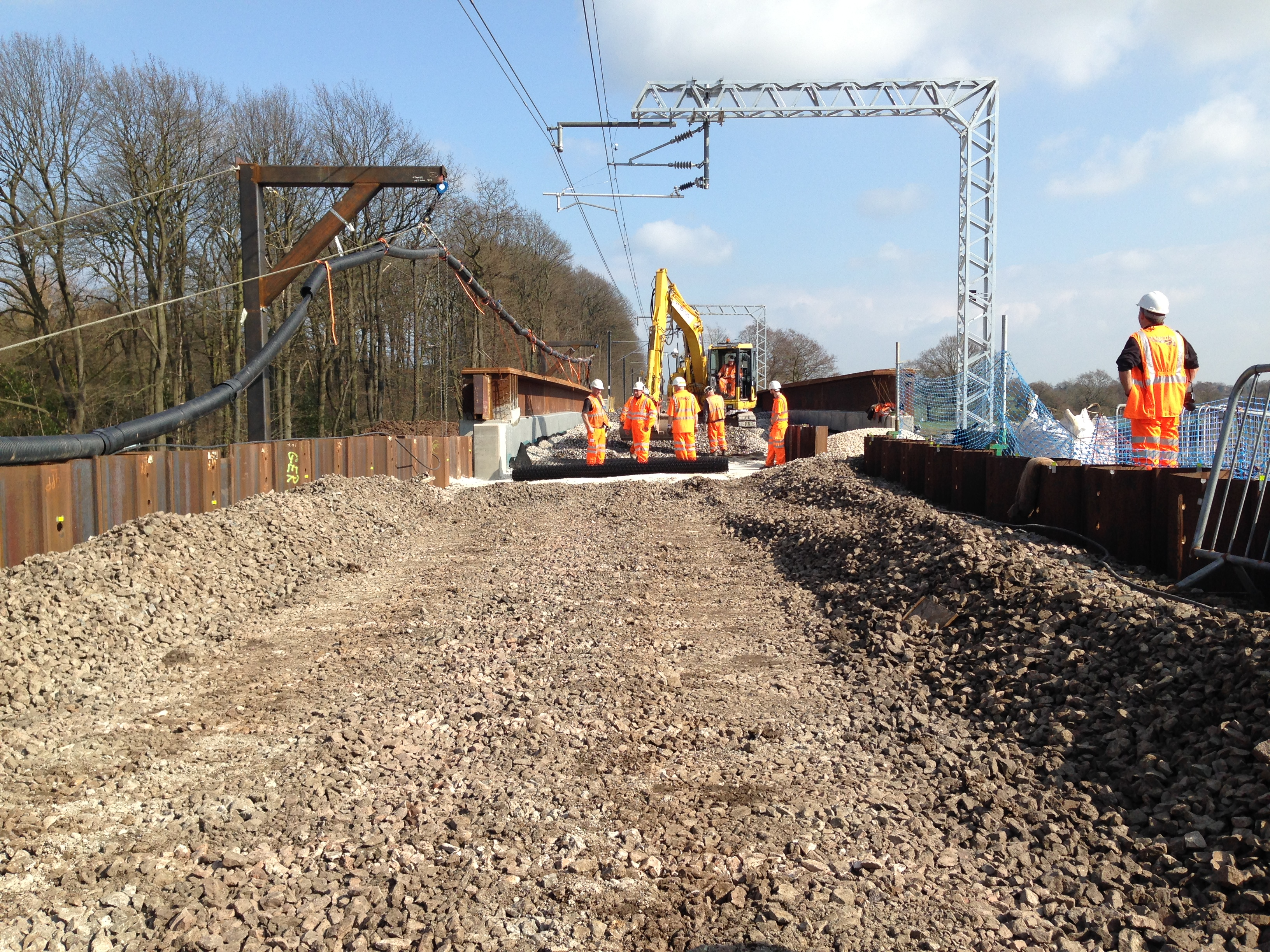 Site workers roll out Tensar geogird on railway track