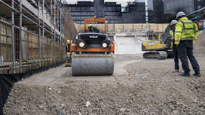Compacting of the geogrid reinforced granular fill